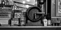 On Tap or Bottle? (Scosanf) Tags: colorado historical museum antiques vintage aged mirror reflections artifacts glassbottles mining beer bar light blackandwhite bw monochrome details travel trip vacation summer montrose canon eos ef2470mmf28lusm 6d topazlabs