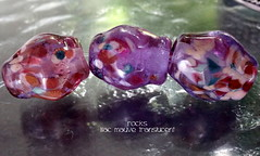 Rocks Lilac Mauve Translucent (Laura Blanck Openstudio) Tags: openstudio openstudiobeads glass handmade lampwork beads bead set jewerly murano big fine arts artist artisan show festival wearable pebbles stones rocks nuggets faceted transparent whimsical funky odd colorful multicolor organic earthy abstract asymmetric frit speckles made usa published winner category south miami translucent shiny lilac lavender violet purple grape pink rose mauve fuchsia green teal burgundy bordeaux ruby