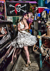 Singing Her Heart Out (landbergmary) Tags: marylandberg conceptualphotography conceptualportrait portrait brave courageous puttingitoutthere uninhibited fearless goldshoes garage skullandcrossbones whitetutu