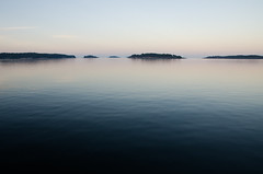 Sea of Isles (Mikael R.) Tags: summer sea island isle archipelago finland water sky blue dusk tree nikond7000 sigma1750mm28landscape serene peaceful calm tranquil wave view landskap vatten hav  skrgrd trd kvll evening