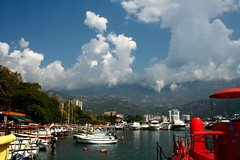 Walking around Budva. (halina.reshetova) Tags: budva montenegro city bluesky clouds people sun sunny sunshine goodweather sunnyday light sea adriaticsea water nature trees boats seafront mountains reflection house building crane vacation travel journey trip travelling white blue black brown green autumn fall september canon canoneos1000d 14092016 30092016 brilliant dragonsdanger