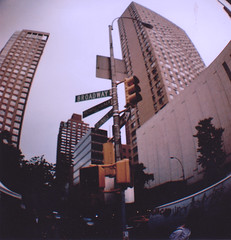 Broadway Highrise New York (Ellis Mitchell) Tags: nyc newyorkcity usa ny newyork 120 film sign america buildings lomo lomography ebay skyscrapers unitedstates kodak urbanoutfitters broadway bored boring fisheye diana tall agfa dianaf ilford facebook hanimex