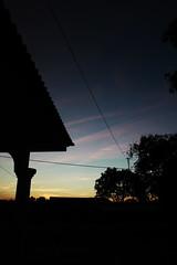 Sunset thru my window (hari{z}ulkarnain) Tags: light sunset orange house color colour tree beach silhouette canon ray view balcony mystical pantai kelantan bachok
