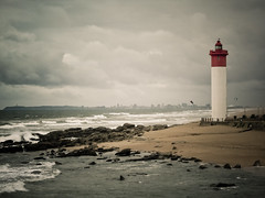 Lighthouse (Channed) Tags: ocean africa travel sky lighthouse holiday storm beach weather clouds southafrica coast indianocean rainy shore afrika zuidafrika beachtown uhmlangarocks uhmlanga chantalnederstigt