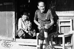 Couple in Ban Houayxay (Umbreen Hafeez) Tags: life light portrait people bw woman white man black male face female dark asian mono blackwhite couple asia faces south ban laos houayxay flickrtravelaward