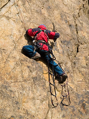 rock climber at ladder (Maxim Tupikov) Tags: people cliff mountain holiday man up sport rock wall danger happy person drive climb movement risk hiking extreme helmet competition rope boulder adventure equipment climbing alpine cap backpacking mountaineering target bouldering acrobat ladder climber activity elevation rockclimbing success hold active mountaineer teamwork belay alpinism adrenalin mountainclimber alpinist extremal
