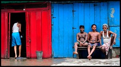 Kolkata - The city of reds and blues (ujjal dey) Tags: street blue red people smile dreams kolkata ujjal nikon50mm nikond90 ujjaldey ujjaldeyin kolkatathecityofredsandblues
