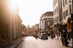 blazing on the street (holding onto gravity) Tags: street light film sunshine 35mm pentax k1000 bokeh vietnam pentaxk1000 filmcamera hanoi colorplus colorplus200 kodakcolorplus analogkodak