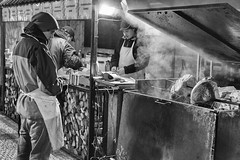 Grilled Meat (Sphaax) Tags: street travel people urban bw cold oneaday czech prague noiretblanc candid streetphotography praha nb meat grill heat czechrepublic pictureaday grilledmeat outdoormarket