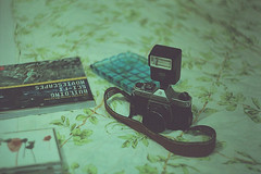 Everyday life (I) (Andrey Timofeev) Tags: camera stilllife film 35mm book bed twilight bedroom bokeh cd room flash blanket strap folds blueglass screwmount  helios44 m39  zenit3m   matthanson  35  asahipentaxk1000 ferraniasolaris400  44 3  buildingscifimoviescapes  summer2012 39 thesciencebehindthefiction foodlastsupper2004