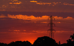 Sunrise over Waterlooville - 05:30 hrs (fstop186) Tags: sunrise dawn breakingdawn sky red orange gold clouds strata electricity pylon lines curves shadows silhouettes industrial city
