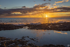 Ko Olina Splash 1 (lycheng99) Tags: koolina koolinabeachresort beach beachresort oahu honolulu hawaii ocean rocks reflections silhouette sky goldenmoment clouds sun sunset landscape nature