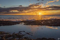 Ko Olina Splash 1 (lycheng99) Tags: koolina koolinabeachresort beach beachresort oahu honolulu hawaii ocean rocks reflections silhouette sky goldenmoment clouds sun sunset landscape nature