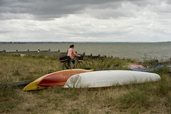 Lady on her bike (jamiethompson01) Tags: whitstable beach uk unitedkingdom august sony a7 zeiss 55mm 18f oysters rain boats bike