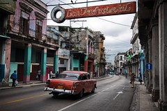 (charlesangus) Tags: sm16163 havana cuba 2010 street road roads car cars red chevrolet old vintage drive driving people crowd walk walking cross crossing sign las spanish color colorful paint painted building buildings stores shops homes houses blue arrow white light lights traffic sidewalk outdoors outside exterior horizontal cuba10022