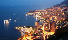 Monte Carlo - Principaut de Monaco (France) (Andrea Moscato) Tags: andreamoscato europe francia monaco principato city citt cityscape night notte notturno view vista vivid overlook light shadow mare sea seascape mediterraneo mediterranean buildings skyscraper skyline blue yellow dark evening paesaggio panorama reflection riflesso costa litorale harbour harbor azzurra golfo boat porto
