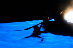 Grotto swim (Sean Prentice) Tags: sea italy swimming canon 7d cave sorrento bluegrotto rowingboat haloeffect cavelight watercave maninwater brilliantbluewater manholdingrowingboat rowingboatinbluegrotto swimminginbluegrotto