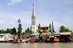 MekongDelta_churchRiver (Karl Muller) Tags: people river boats temple tank markets vietnam powerlines monks tunnels mekongdelta cuchi saigon hochiminhcity trap machinegun ricewine m60 snakewine
