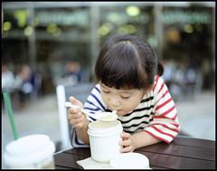 Hungry. (MichelleSimonJadaJana) Tags: portrait 120 girl childhood japan analog children tokyo kid pentax scanner documentary lifestyle snaps jana  epson medium format  6x7 90mm smc f28 67ii flatbed jada pentax67 vuescan v750 gtx970