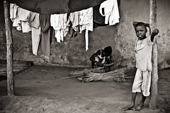 Beninese life (NeSlaB ф.) Tags: poverty africa boy blackandwhite woman look canon blackwhite kid traditional culture photojournalism belief tribal clothes benin tradition tribe ethnic developingcountries reportage nationalgeographic afrique ethnography ethnology okome ethnies aheme possotome neslab sehomi