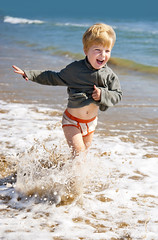 happy kid running on the sea beach (Maxim Tupikov) Tags: ocean trip family boy sea summer vacation baby holiday playing game hot beach nature water beautiful beauty smiling youth laughing relax fun toy outside happy kid healthy sand funny warm child wind outdoor exploring joy young wave sunny running suit together rest leisure summertime recreation sight activity splash find active