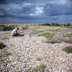 mary, in crimson trousers - dungeness (chirgy) Tags: november sky crimson clouds stones cords horizon mary pebbles trousers dungeness lubitel166 month concentrating grieve seakale autaut emmafenjiy