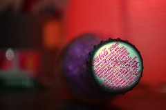 Focus the Cola (zetakr) Tags: red glass closeup out bottle nikon focus close purple awesome magenta cap cover cocacola lid mustsee glassbottle nikond3100
