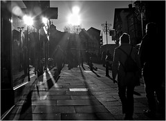 333/366 Standishgate Flare (Mister Oy) Tags: blackandwhite bw monochrome silhouette retail mono shadows daily lensflare fujifilm 365 shoppers wigan davegreen 366 x100 1aday standishgate contrahour oyphotos fujix100