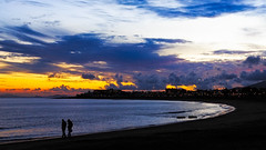 In confidence (Barry_Madden) Tags: sunset sea beach silhouette clouds lights town seaside spain couple chat walk lanzarote canarias canaryislands tas confiding beachtown