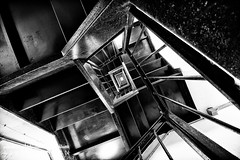 Hostel [EXPLORED] (Aaron Yeoman) Tags: city uk greatbritain travel england urban blackandwhite bw london lines architecture stairs dark spiral blackwhite europe unitedkingdom empty perspective gritty line creepy staircase gb carpark spiralstaircase grungy a77 leadinglines repetitive henriettaplace sigma1020mm1456exdchsm sonya77 slta77 sonyalphaslta77