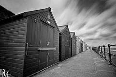 Mundesley 12 (davemoly17) Tags: davidmolyneuxphotography sea seaside beach beachhuts coast sand groynes waves water mundesley norfolk lifeboat sunny canon eos 1100d sigma wideangle