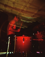 Sean of Mon Freres Amigos drumming--double- or triple-exposure (DannyOKC) Tags: doubleexposure mx colorsplash red flash drum drummer band practice double triple exposure 120 mediumformat garage rock roll