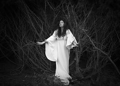 Towards The Light (Maren Klemp) Tags: fineartphotography fineartphotographer blackandwhite monochrome selfportrait portrait woman nature branches trees thewoods fairytale white dress evocative ethereal expressive conceptual surreal fineart symbolic naturallight melancholy vintage nostalgic canon darkart