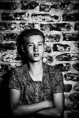 Floris (5) (Hans Dethmers) Tags: jongen boy kind model bricks stenen muur wall crossedarms zwartwit monochrome blackandwhite hansdethmers