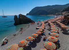 Monterosso al Mare (bjfultn) Tags: beach ocean seascape summer umbrella sand blue orange monterosso tokina nikon travel italy cinque terre town sun water