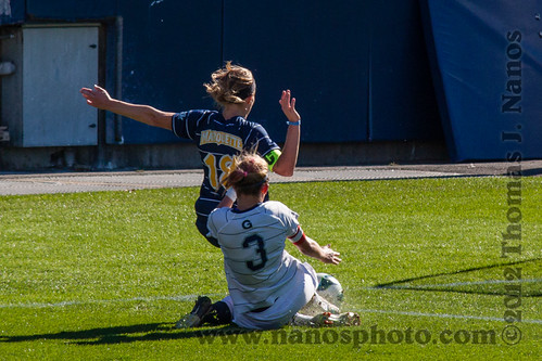 "Giving it their all.  Marquette's Rachael Sloan battles Georgetown's Emily Menges for the ball near the Georgetown goal. • <a style=""font-size:0.8em;"" href=""https://www.flickr.com/photos/20365595@N04/8162909256/"" target=""_blank"">View on Flickr</a>"