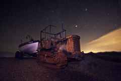 Space hulk (Nick Caro - Photography) Tags: longexposure tractor beach yellow cat stars boat rust stones space norfolk caro hulk gravel northnorfolk nickcaro wwwnickcarophotographycouk
