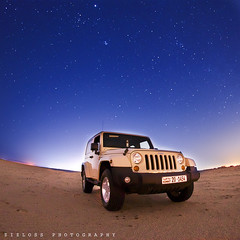 Jeep Wrangler.. (ZiZLoSs) Tags: longexposure blue sky car night stars star long exposure nightshot jeep wide fisheye explore kuwait aziz wrangler zizloss 3azeez 3aziz canoneos7d abdulazizalmanie
