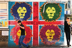 Sorry I'm in the frame (5ERG10) Tags: street blue red england haven green london sergio hat yellow wall corner graffiti europe colours purple eating weekend finger candid flag bricks sunday lion lions walls colourful camdentown passerby nw1 fishchips notbansky amiti 5erg10