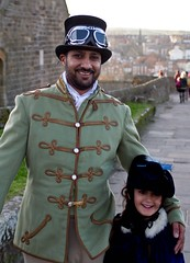 7D0050 Man in Military coat & Top Hat with goggles & his little girl - Whitby Goth Weekend 3rd Nov 2012 (gemini2546) Tags: nov goth week 3rd black 2470 man girl canon sigma little top 7d lens asian hat coat jacket fur collar whitby 2012 millitary goggles beard