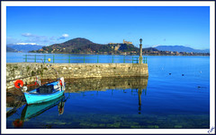 Arona the pier, against the backdrop Castle Angera (Tizi@no56 (painting with light)) Tags: sky panorama lake castle water clouds landscape lago pier boat barca nuvole postcard cielo molo cartolina lagomaggiore arona mygearandme mygearandmepremium mygearandmebronze mygearandmesilver rememberthatmomentlevel4 rememberthatmomentlevel1 rememberthatmomentlevel2 rememberthatmomentlevel3 rememberthatmomentlevel7 rememberthatmomentlevel9 rememberthatmomentlevel5 rememberthatmomentlevel6 rememberthatmomentlevel8 rememberthatmomentlevel10 catellodiangera