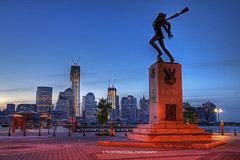 New Day, New York (TIA International Photography) Tags: world plaza new york city nyc morning blue sky sculpture ny tower silhouette statue skyline sunrise tia river dawn freedom early spring construction memorial war long cityscape waterfront place russia manhattan district telephone wwii 911 poland landmark center ii promenade jersey wtc hudson lower distance guerre trade financial exchange metropolitan katyn tosin springtime finance arasi visipix tiascapes ©tiainternationalphotography monidale