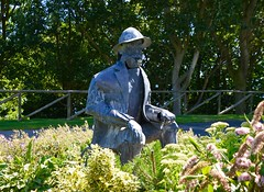 The Filey Fisherman (rustyruth1959) Tags: nikon nikond3200 tamron16300mm yorkshire filey outdoor sculpture fisherman gardens green leaves metal hat pipe flowers man trees fence path