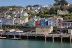 Kingswear (Jeanni) Tags: steam train houses colourful pier station red blue yellow river