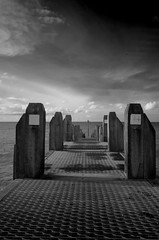 Seaside post (Sundornvic) Tags: bw blackwhite sea seaside posts water sky ir pentaxart