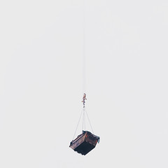 Looney Tunes (Olly Denton) Tags: looneytunes skip hanging crane mist fog sky cloud summer suspend industry construction lines perspective iphone iphone6 6 vsco vscocam vscolondon ios apple mac victoria westminster london uk