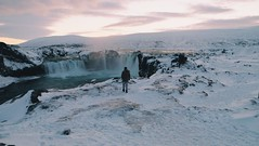 Winterland (Kit.Tan) Tags: winter frozen waterfall water landscape snowcapped snowcovered snowmountain river white wanderlust destination travel nonurbanscene remote scenic tranquil cold beautyinnature outdoor alone man sunset naturallight sunlight godafoss iceland