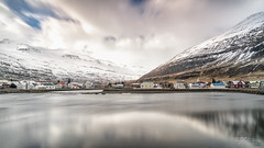 Seydisfjördur (Rkitichai) Tags: seydisfjördur iceland fjord lake water travel travelphotography reflection houses village town mountain snow winter windy landscape landscapephotography outdoor nature naturephotography scenery wanderlust rkitichaicom batis225 e carlzeiss