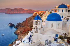 (Andy Bracey -) Tags: bracey andybracey greece oia santorini aegean sea coast coastal water sunset pink coral town church dome blue landscape seascape cliff hill boat cross religion gate bell