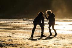 Dance with me... (Deborah Kelland) Tags: beach people lowlight sea seaside sepia woman man fun happy light